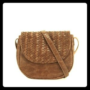 Neiman Marcus faux leather brown saddle bag. NWT.