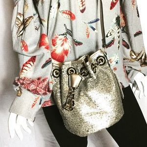 Handbags - Low stock Champagne sequin bucket bag NWT