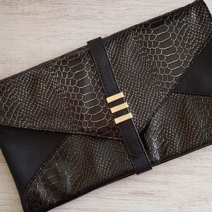 Black clutch with snakeskin pattern