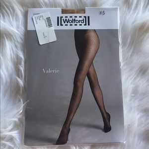 Wolford nude mesh pattern tights. Xs