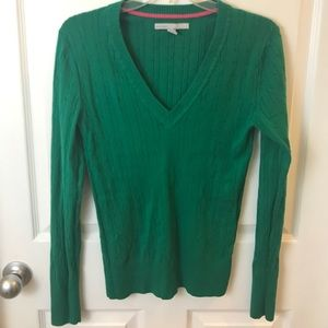 Green long-sleeve cable sweater