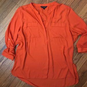 Roll tab sleeve blouse.