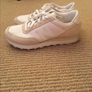 Tan and white new balance sneakers