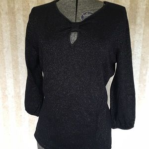 Sparkly black sweater.
