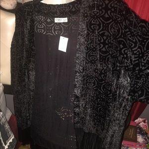 Black shrug with fringe