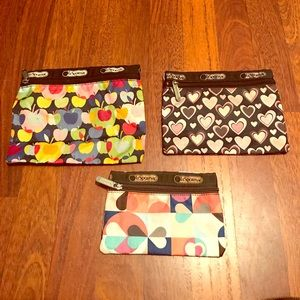 Set of 3 used lesportsac print cosmetic bags