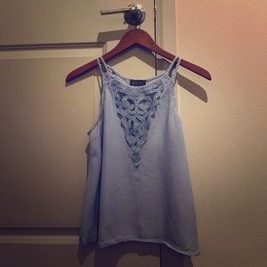 Light blue tank with intricate detailing.