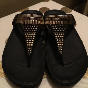 Black and gold fitflop
