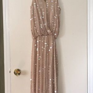 Tan sequined gown. Never worn . Stunning on ,
