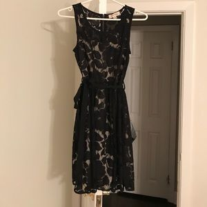 Lacy black dress with nude slip