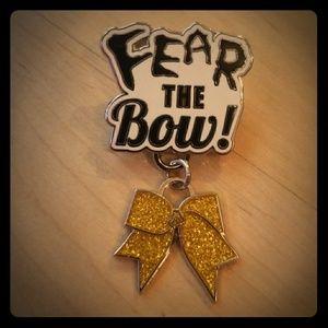 VARSITY Fear the Bow Gold Cheer Pin