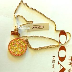 NWT Coach gold plated DISC Necklace pink crystal.