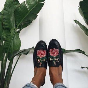 Black loafer slides with roses