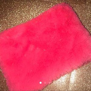Pink fuzzy clutch