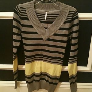 Black, gray, and yellow striped sweater