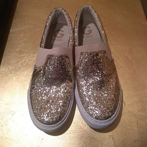 Guess brand slip on gold shoe
