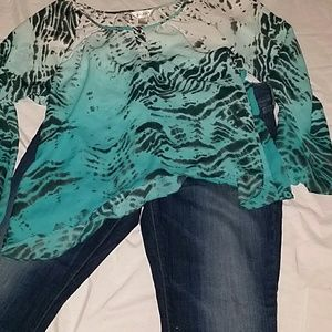 Kenar Tunic Turquoise, black and white colors.