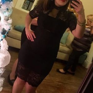 Black lace dress. Zips in the back.
