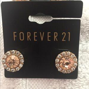 Round stone peach stone with diamonds earrings