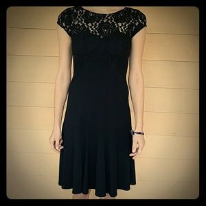 Black dress with rose pattern lace detail