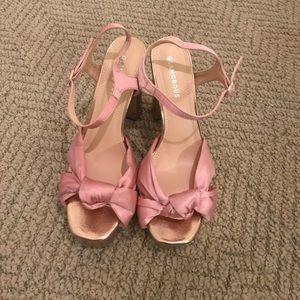 Pink and gold platform heel sandal.
