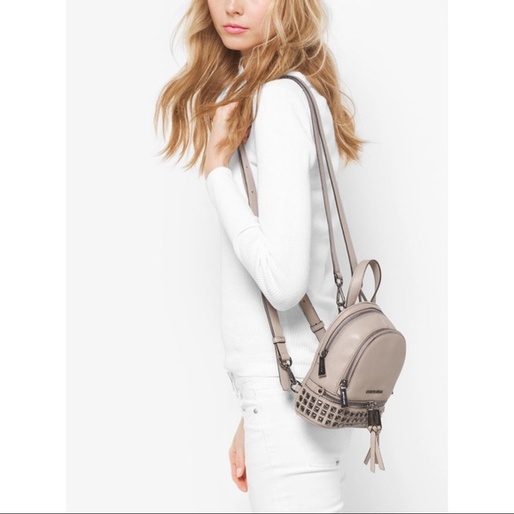 ae2d6b93e525 Michael Kors Rhea Zip Extra Small Backpack. M_59e287bc4225be268c033e3e