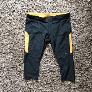 Nike gray and orange running capris