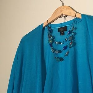 Three quarter length sleeve, bright blue cardigan