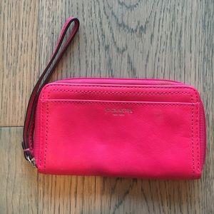 Pink COACH wristlet / wallet