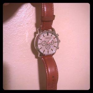 Men's Fossil Watch with sleek wallet.