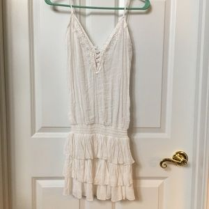 Cute white dress with lace detail.
