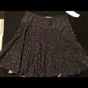 Silk pleated skirt with speckle detail