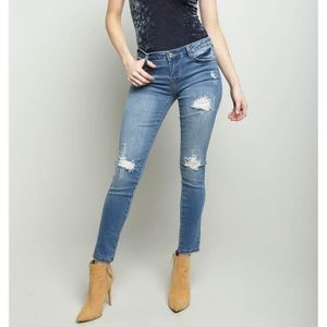 Pants - Distressed Mid Rise Skinny Jeans