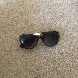 Brown rimmed sunglasses with copper sides