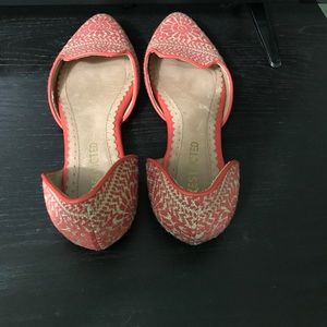 Restricted pink flats