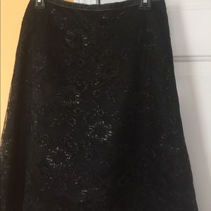 Limited lace overlay skirt