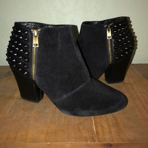 Black spiked heel booties by Jessica Simpson