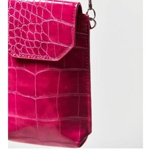 Urban Outfitters pink crocodile purse