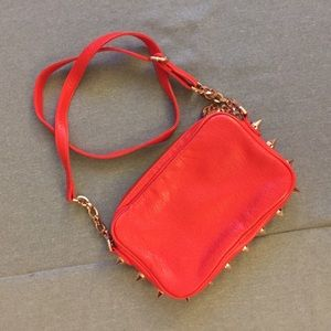 Edgy Deux Lux leather cross body bag w/ pocket