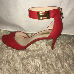 Red, open-toe, ankle strap heels
