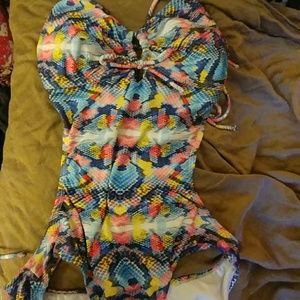 Multi colored snake skinned bathing suit. New