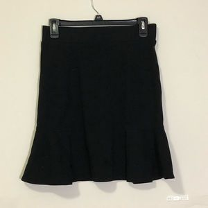 Sophie Max: black stretchy pleated skirt