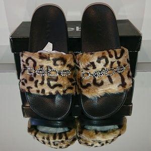 New in box rare BEBE leopard slides