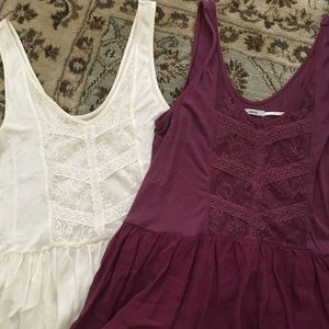 Very soft flowy tanks. Selling both together.