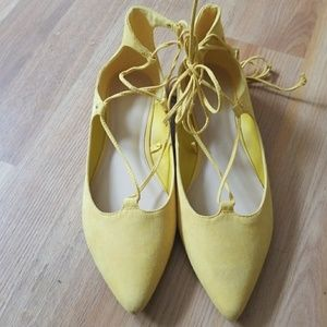 Yellow Flat ankle strap ballerina shoe.