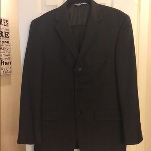 Men's brown suit with square pattern