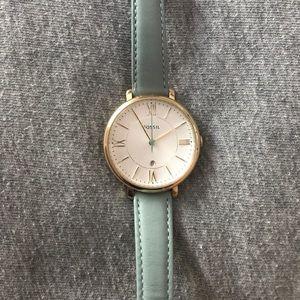 Women's Fossil brand watch.