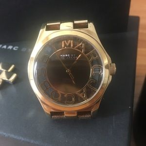 Woman's gold Marc by Marc Jacobs watch.