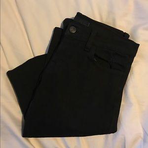 Black, ripped J brand jeans.