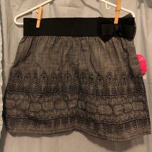 Grey and black mini skirt